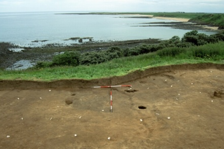 The Mesolithic hut at Howick, Northumberland, dated to 7800 BC,  overlooking the modern day coastline, (Source).